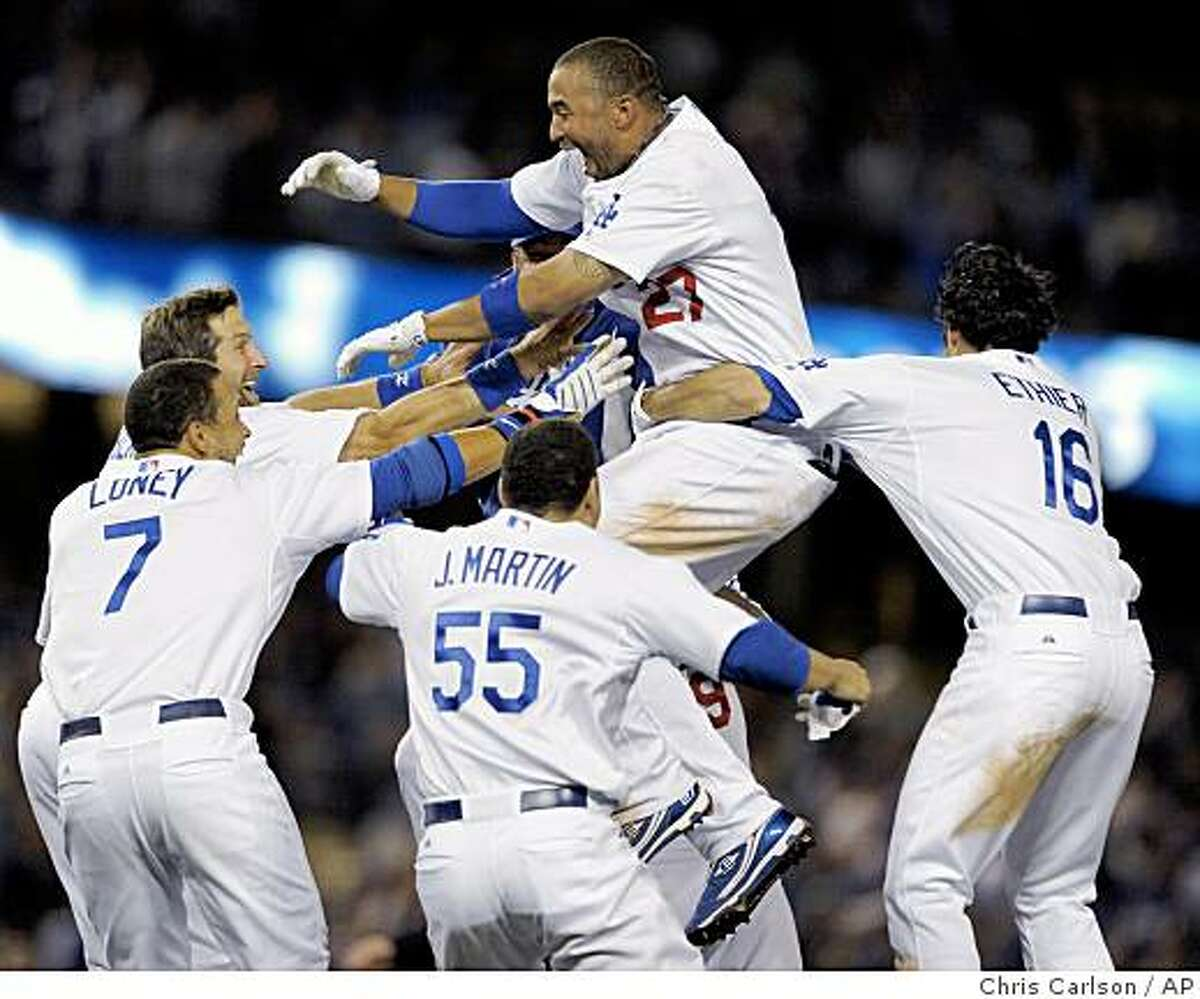 Los Angeles Dodgers' Matt Kemp, top, celebrates his game-winning RBI single against the Oakland Athletics in the bottom of the 10th inning of a baseball game in Los Angeles, Tuesday, June 16, 2009. (AP Photo/Chris Carlson)