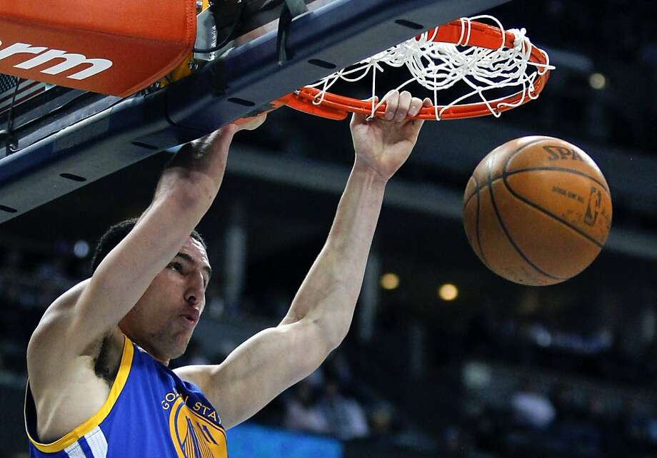 Golden State Warriors guard Klay Thompson (11) dunks against the Denver Nuggets during the fourth quarter of an NBA basketball game Thursday, Feb. 9, 2012 in Denver. The Warriors won 109-101. (AP Photo/Barry Gutierrez) Photo: Barry Gutierrez, Associated Press