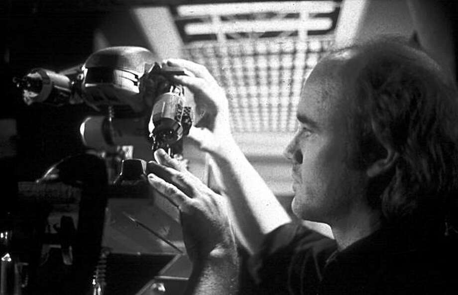 "Phil Tippett animates the ED-209 from ""RoboCop."" Photo: Courtesy, Tippett Studio"