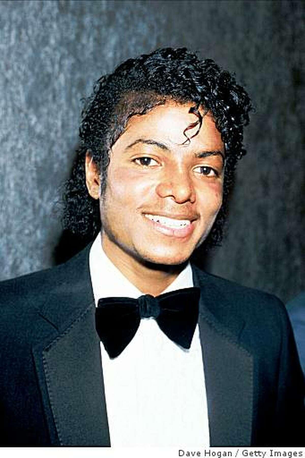 Singer Michael Jackson smiles in 1983 in London.