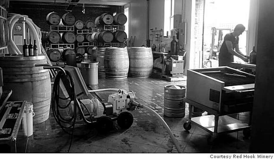 On-site winemaker CHRISTOPHER NICOLSON on the floor of the Red Hook Winery in Brooklyn, NY, March 10, 2009. The winery is a collaboration of New York wine distributor Mark Snyder and two California winemakers: Abe Schoener and Bob Foley. Photo: Courtesy Red Hook Winery