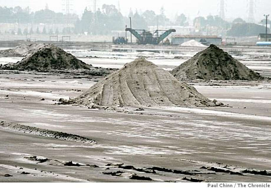 Mounds of salt are piled high at the Cargill salt evaporators in Redwood City, Calif. on Wednesday, Oct. 31, 2007. Cargill hopes to develop the 1,400 acre site which is angering environmentalists saying it should be restored to original wetlands open space. Photo: Paul Chinn, The Chronicle