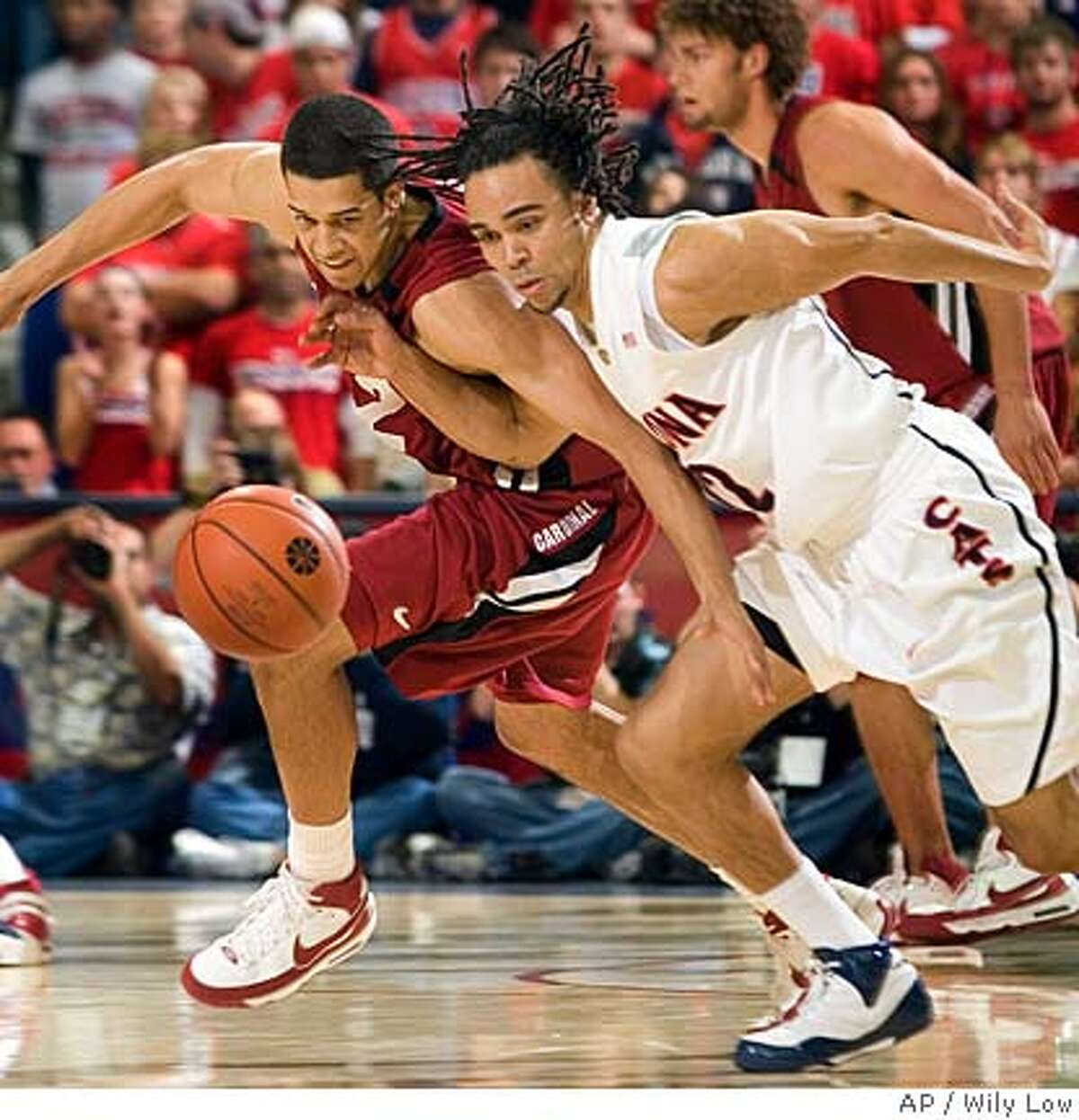 Stanford's Landry Fields, left, and Arizona's Daniel Dillon battle for a loose ball in the first half of a college basketball game at McKale Center in Tucson, Ariz., Saturday, Feb. 16, 2008. (AP Photo/Wily Low)