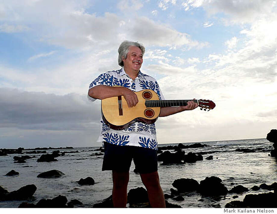TRAVEL ALOHA FRIDAY -- Grammy-winning Hawaiian slack-key guitarist Keola Beamer leads music camps on the island of Molokai. Photo: Mark Kailana Nelson