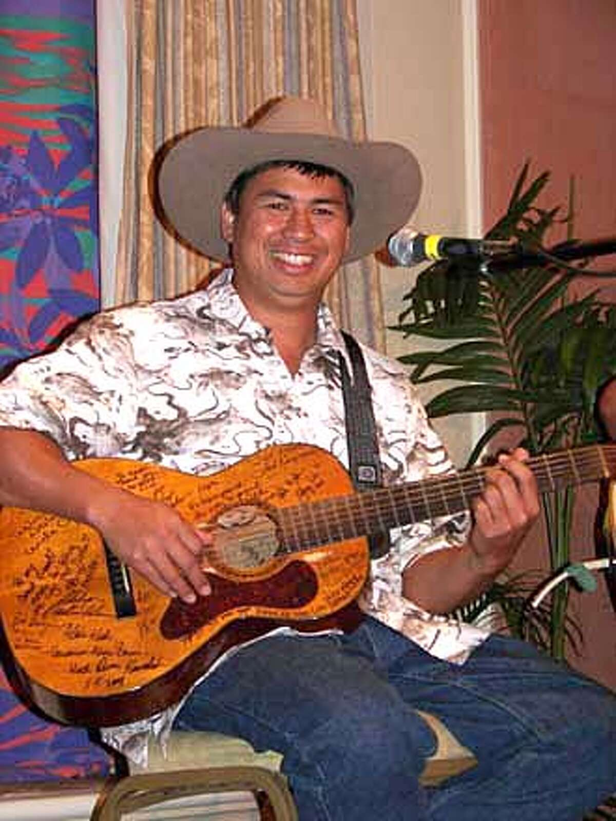 TRAVEL HAWAII -- Keoki Kahumoku, slack-key guitarist, singer and songwriter, performs regularly at the Napili Kai Beach Resort on Maui and teaches workshops at the Kahumoku Ohana Music Camp in Pahalo on the Big Island of Hawaii.