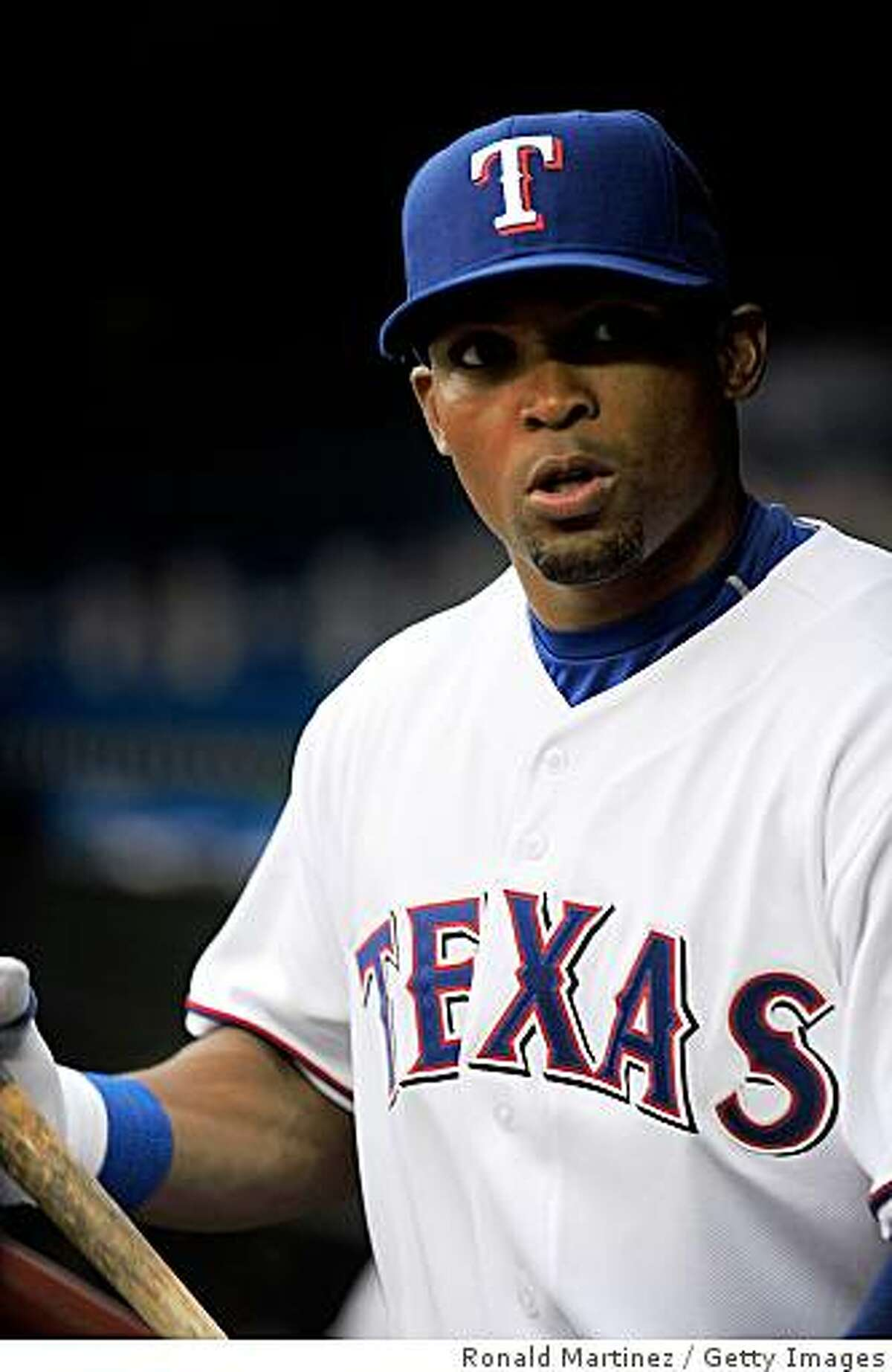 ARLINGTON, TX - APRIL 15: Left fielder Marlon Byrd #22 of the Texas Rangers on April 15, 2009 at Rangers Ballpark in Arlington, Texas. (Photo by Ronald Martinez/Getty Images)