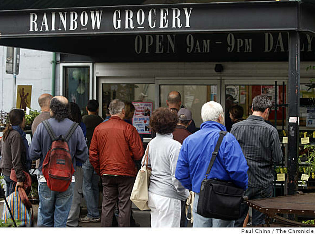 A crowd of shoppers, many holding discount coupons clipped from the phone book, wait for Rainbow Grocery to open in San Francisco, Calif., on Thursday, June 11, 2009.