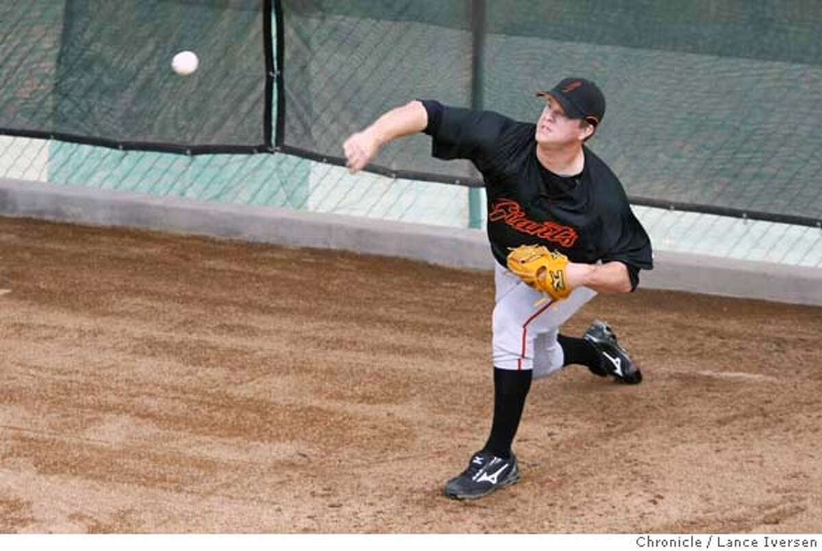 Matt Cain warms up Thursday. San Francisco Giants pitchers and catchers took part in their first official team workout at Scottsdale Stadium Thursday morning as they get ready for the opening of the Cactus League. By Lance Iversen/The San Francisco Chronicle MANDATORY CREDIT PHOTOG AND SAN FRANCISCO CHRONICLE/NO SALES MAGS OUT