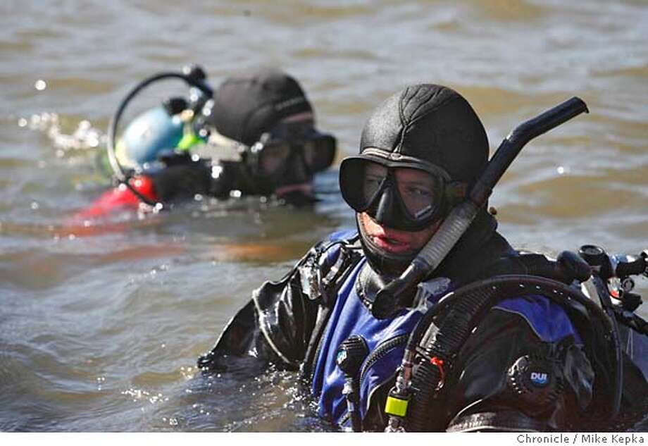 Patrick Foy and Jonathan Nelson (rt), divers with the California Dept. of Fish and Game search the Calero Reservoir for invasive non-navtive species called the Zebra mussel, Quagga mussel and the New Zealand mud snail. After brief investigation they found no signs of these creatures. Mike Kepka / The Chronicle MANDATORY CREDIT FOR PHOTOG AND SAN FRANCISCO CHRONICLE/NO SALES-MAGS OUT Photo: Mike Kepka