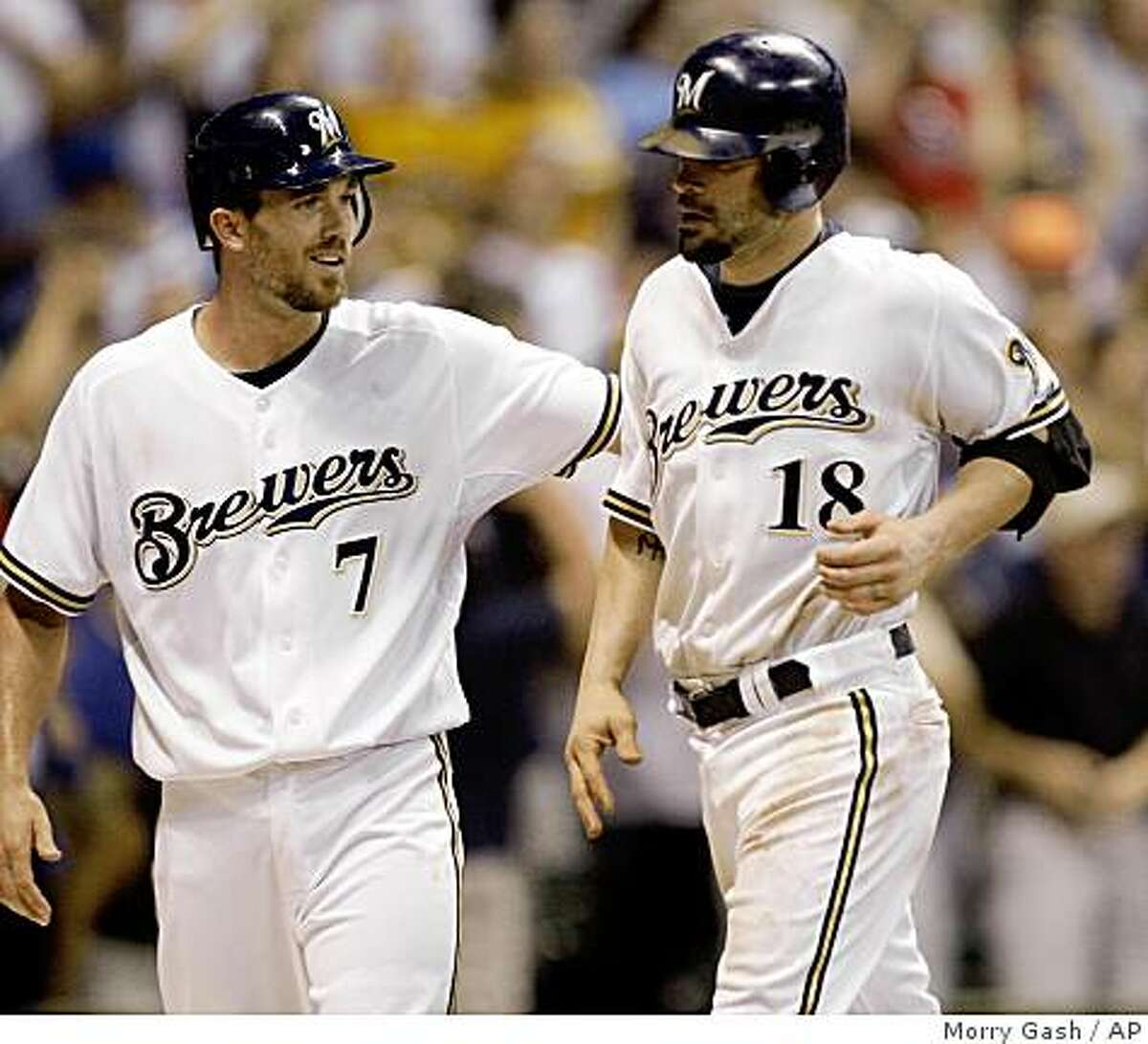 Milwaukee Brewers' J.J. Hardy (7) congratulates Jason Kendall (18) during the eighth inning of a baseball game against the Minnesota Twins on Wednesday, June 24, 2009, in Milwaukee. Hardy scored on a double by Kendall who scored on a throwing error. The Brewers won 4-3. (AP Photo/Morry Gash)