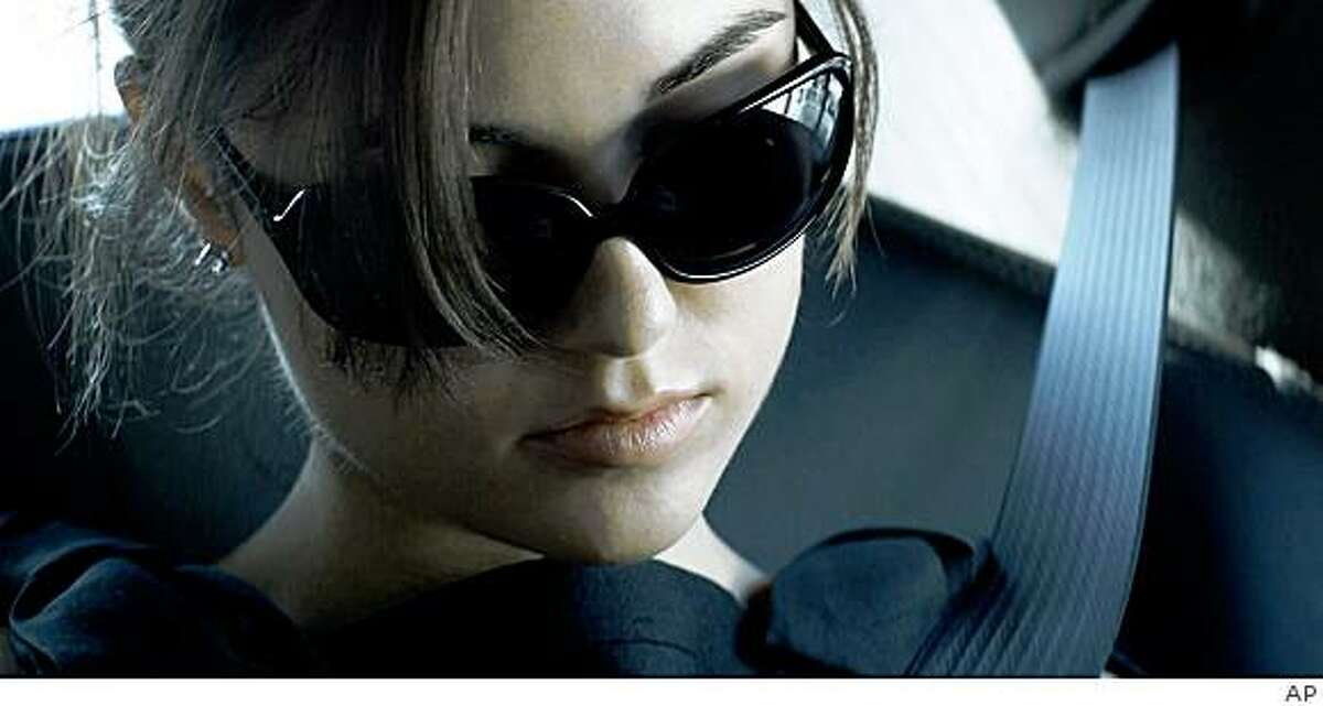 In this film publicity image released by Magnolia Pictures, Sasha Grey is shown in a scene from Steven Soderbergh's film,