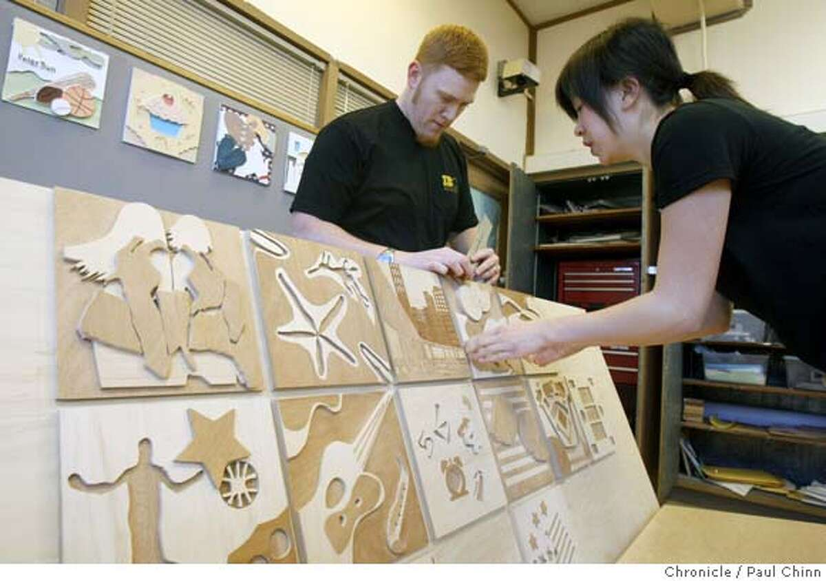 San Francisco State students Ryan Pugh and Jennifer Cheung attach tiles designed by high school students onto the bench. Students from Thurgood Marshall High School build a bench with Industrial Design students from San Francisco State in San Francisco, Calif. on Thursday, Feb. 14, 2008. PAUL CHINN/San Francisco Chronicle MANDATORY CREDIT FOR PHOTOGRAPHER AND S.F. CHRONICLE/NO SALES - MAGS OUT