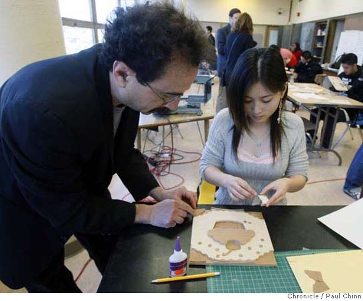Martin Linder, coordinator of the bench-building program, helps Linda Huang with her design. Students from Thurgood Marshall High School build a bench with Industrial Design students from San Francisco State in San Francisco, Calif. on Thursday, Feb. 14, 2008. PAUL CHINN/San Francisco Chronicle MANDATORY CREDIT FOR PHOTOGRAPHER AND S.F. CHRONICLE/NO SALES - MAGS OUT