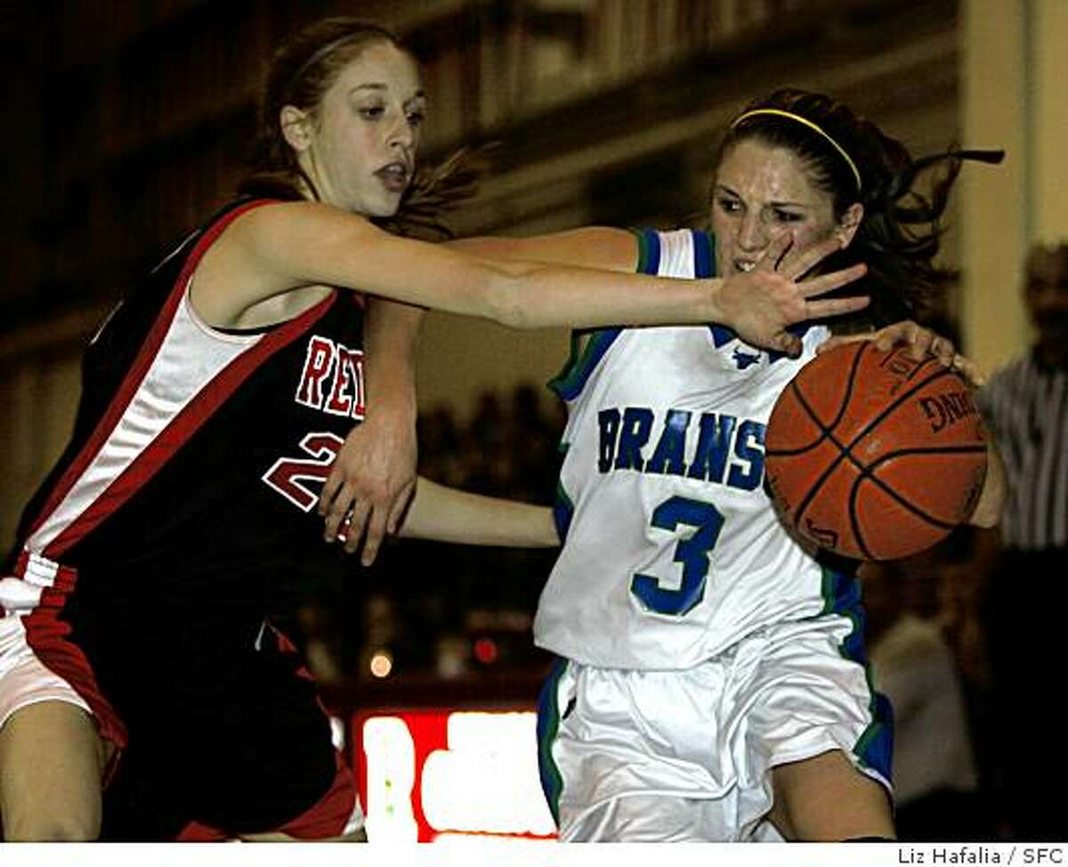 Branson vs. Redwood--High school basketball, girls Marin County Athletic League playoff. Branson's #3 Lauren Polansky drives through Redwood's #23 Tobyn Celler during the second half of the game. Photo by Liz Hafalia/San Francisco Chronicle