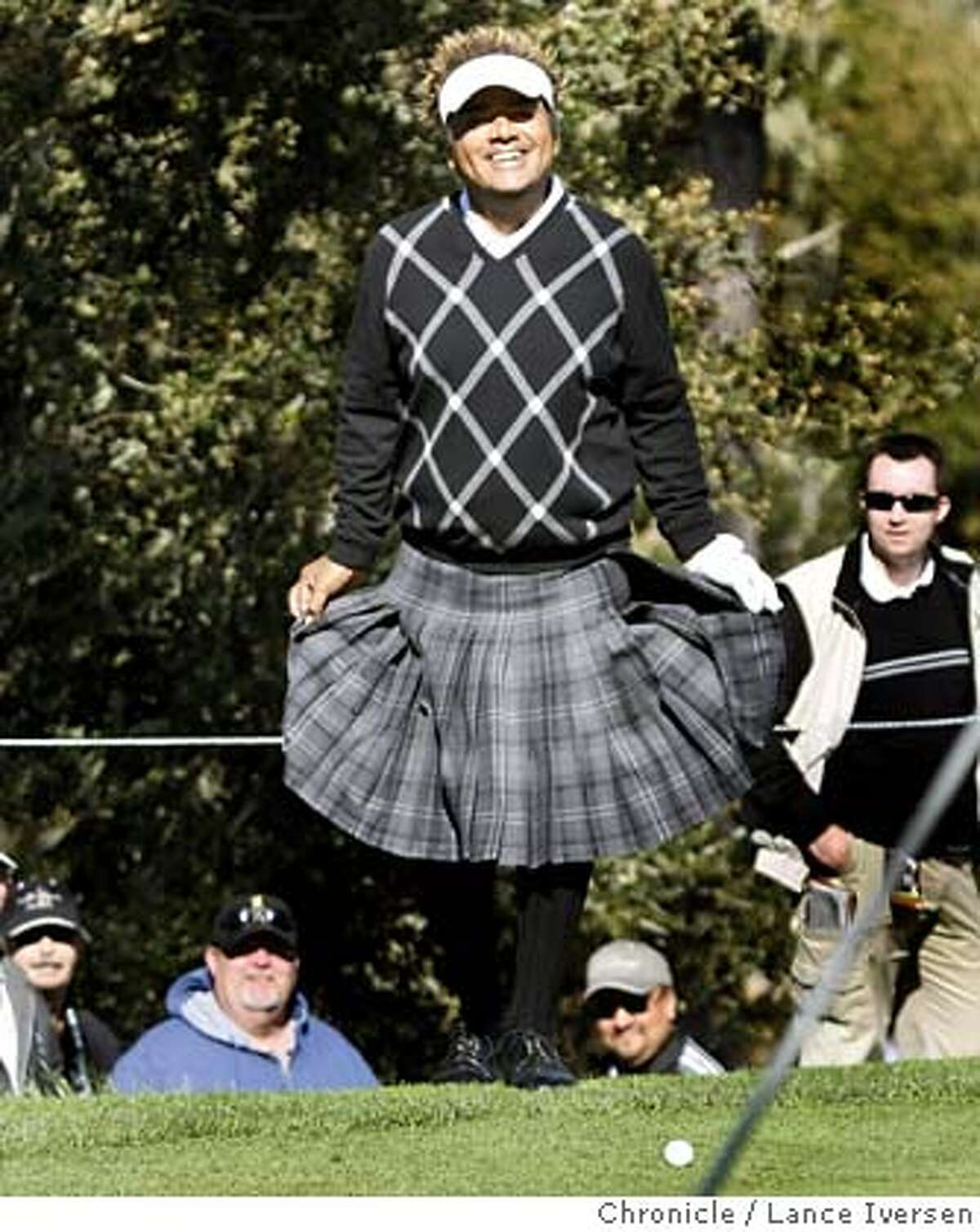 Actor/Comedian George Lopez sporting a kilt does a curtsy on the 14th green at Spy Glass Hill after blasting out of the trap much to the delight of the galley. The second round of the annual AT&T Pebble Beach National Pro-Am got under way with a number of new names leading the tournament. By Lance Iversen/The Chronicle 2nd round of the annual AT&T Pebble Beach National Pro-Am. By Lance Iversen/The Chronicle MANDATORY CREDIT PHOTOG AND SAN FRANCISCO CHRONICLE/NO SALES MAGS OUT