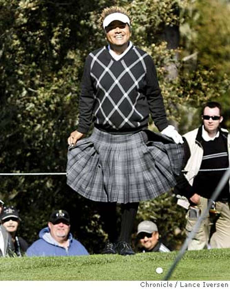 Actor/Comedian George Lopez sporting a kilt does a curtsy on the 14th green at Spy Glass Hill after blasting out of the trap much to the delight of the galley. The second round of the annual AT&T Pebble Beach National Pro-Am got under way with a number of new names leading the tournament. By Lance Iversen/The Chronicle 2nd round of the annual AT&T Pebble Beach National Pro-Am. By Lance Iversen/The Chronicle MANDATORY CREDIT PHOTOG AND SAN FRANCISCO CHRONICLE/NO SALES MAGS OUT Photo: Lance Iversen