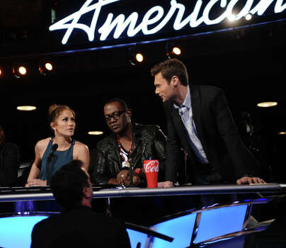 Jennifer Lopez, Randy Jackson and Ryan Seacrest at the judges desk during the Hollywood round on AMERICAN IDOL. CR: Michael Becker / FOX. (                                                      )