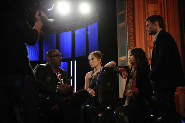 Randy Jackson, Jennifer Lopez, Steven Tyler and Ryan Seacrest at the judges desk during the Hollywood round on AMERICAN IDOL. CR: Michael Becker / FOX. (                                                      )