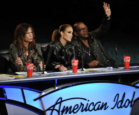 Steven Tyler, Jennifer Lopez and Randy Jackson at the judges table during the Hollywood round on AMERICAN IDOL. CR: Michael Becker / FOX. (                                                      )