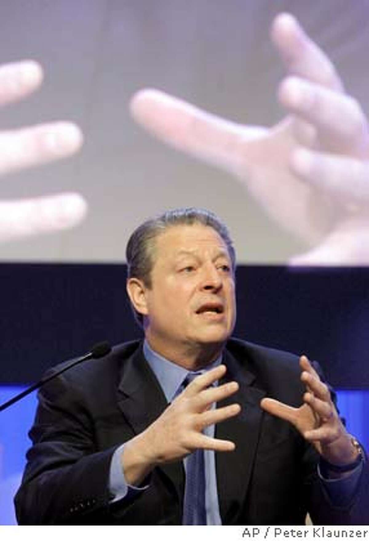 Former US-Vice President, Nobel Peace laureate Al Gore, speaks during a plenary session on the second day of the Annual Meeting of the World Economic Forum, WEF, in Davos, Switzerland, Thursday, Jan 24, 2008. Top business leaders, heads of state from around the world as well as representatives of NGOs will gather here until Sunday, Jan. 27. (AP Photo/Keystone, Peter Klaunzer)