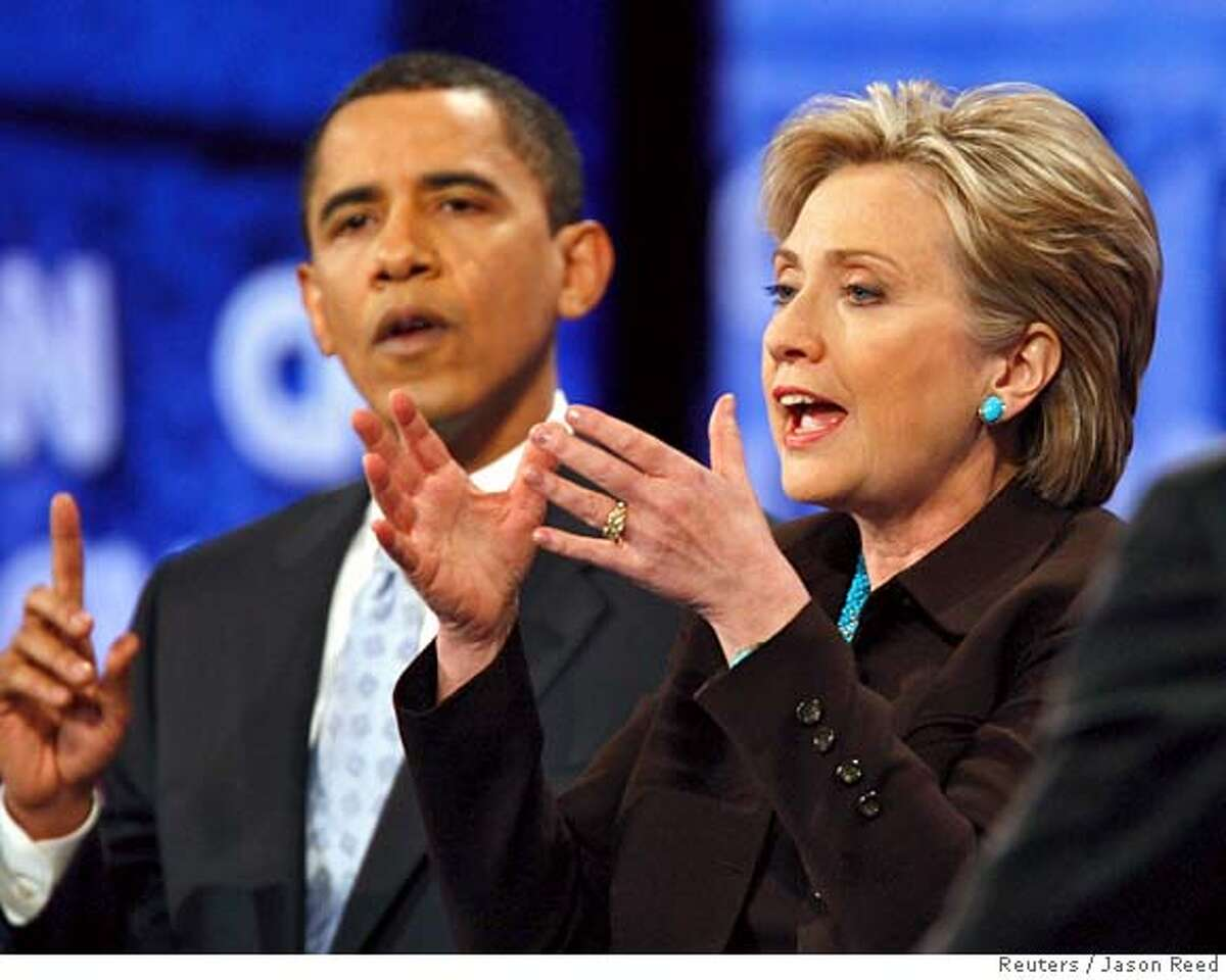 Democratic presidential candidates US Senator Barack Obama (D-IL) (L) and US Senator Hillary Clinton (D-NY) gesture during the CNN/Los Angeles Times Democratic presidential debate in Hollywood, California January 31, 2008. REUTERS/Jason Reed (UNITED STATES) US PRESIDENTIAL ELECTION 2008 USA