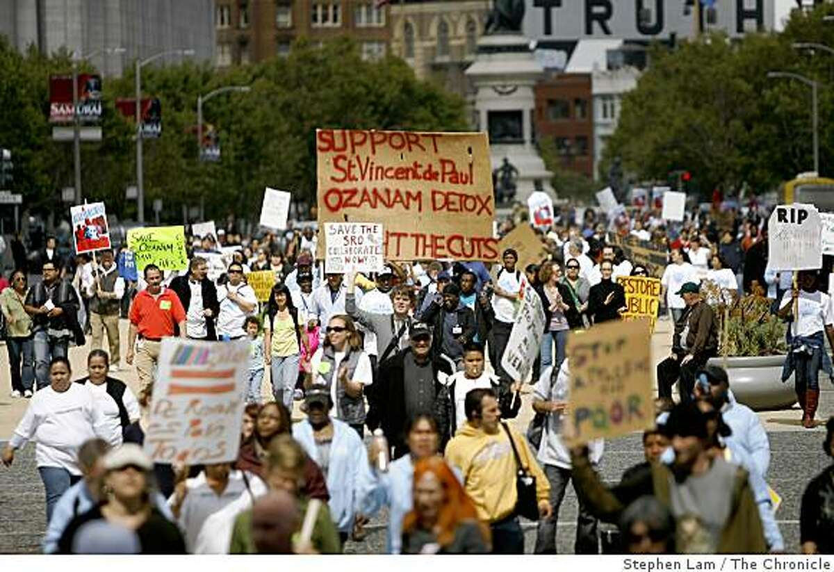 Hundreds of demonstrators march towards San Francisco City Hall in protest of Mayor Gavin Newsom's budget at Civic Center Plaza in San Francisco, Calif. on Wednesday June 10, 2009.