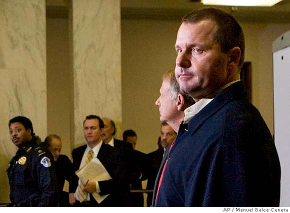 Baseball pitcher Roger Clemens, joins his lawyers in a news conference on Capitol Hill, Thursday, Feb. 7, 2008 in Washington. The seven-time Cy Young Award winner denied his former trainer Brian McNamee's allegations in the Mitchell Report about drug use. (AP Photo/Manuel Balce Ceneta)