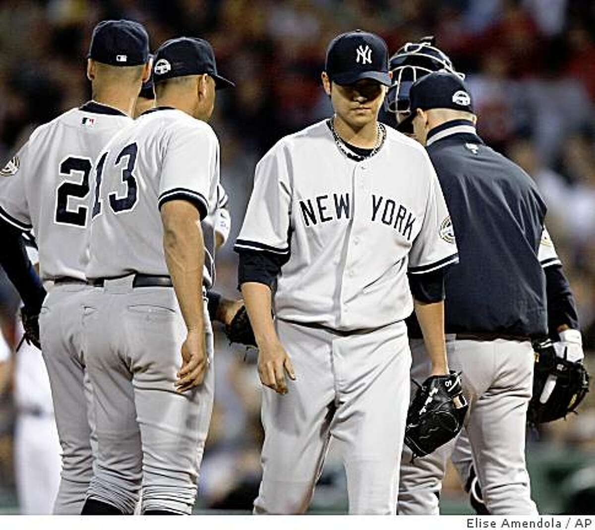 New York Yankees starting pitcher Chien-Ming Wang departs in the third inning against the Boston Red Sox during a baseball game at Fenway Park in Boston on Wednesday, June 10, 2009. (AP Photo/Elise Amendola)