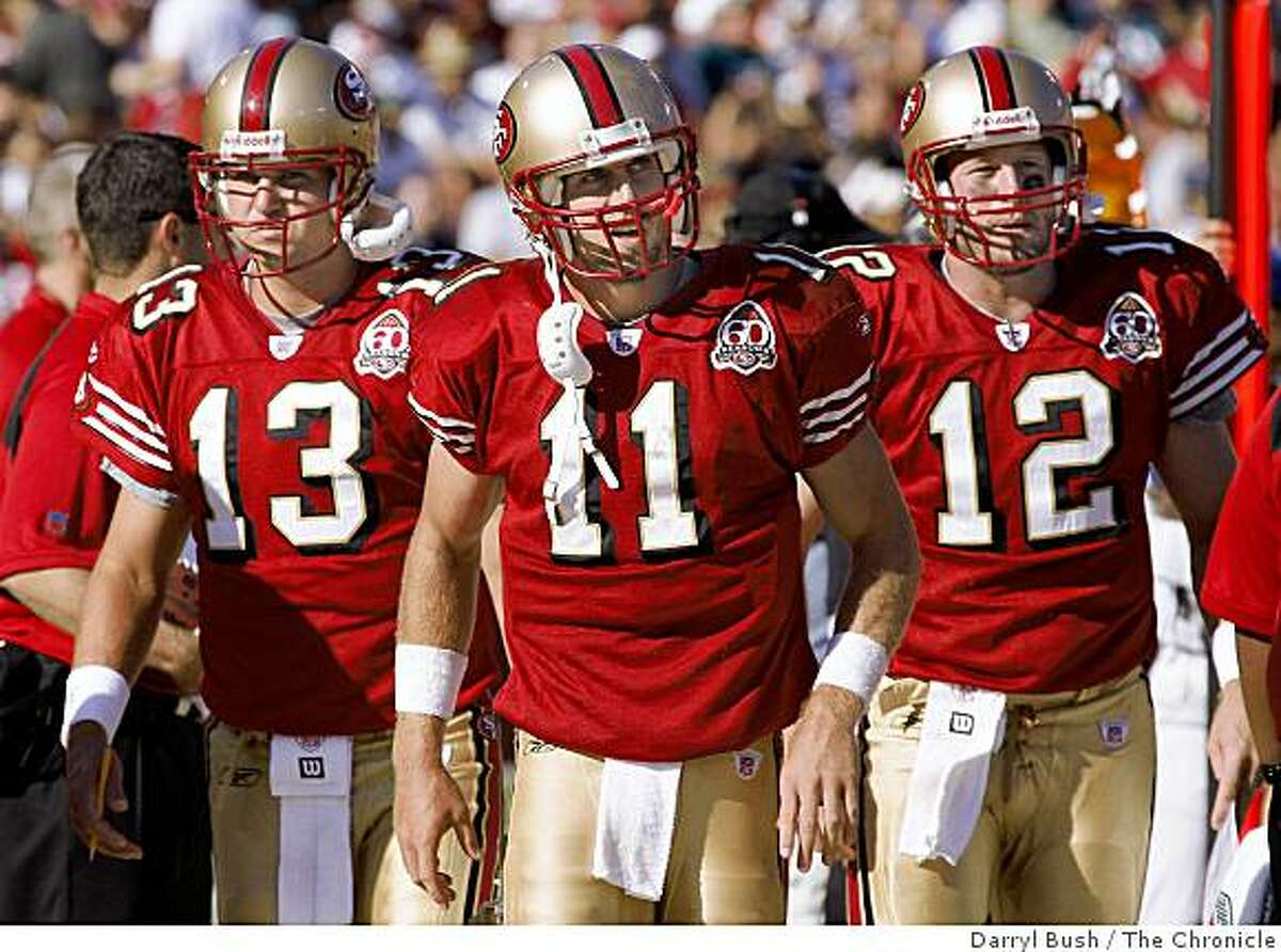 49ers quarterbacks, Shaun Hill (13), Alex Smith (11), center, and Trent Dilfer (12) on the sidelines during the game between San Francisco 49ers vs. Philadelphia Eagles at Monster Park in San Francisco, CA on Sunday, September 24, 2006. 9/24/06 Darryl Bush / The Chronicle