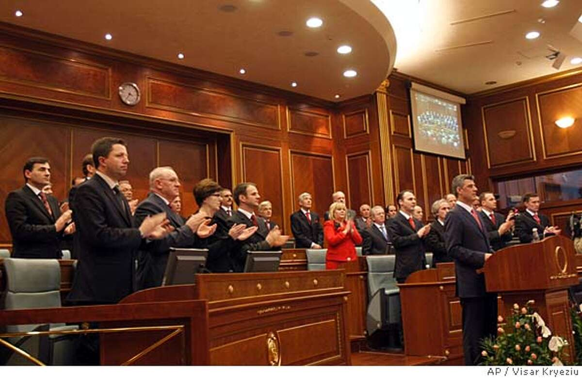 Kosovo's Prime Minister Hashim Thaci, 3rd right, addresses to the members of the Parliament as the members of his government applaud during a special session of the Parliament in Pristina, Sunday, Feb. 17, 2008. Kosovo's ethnic Albanian leadership called a special session of parliament Sunday to declare independence _ a bold and historic bid for statehood in defiance of Serbia and Russia.(AP Photo/Visar Kryeziu)