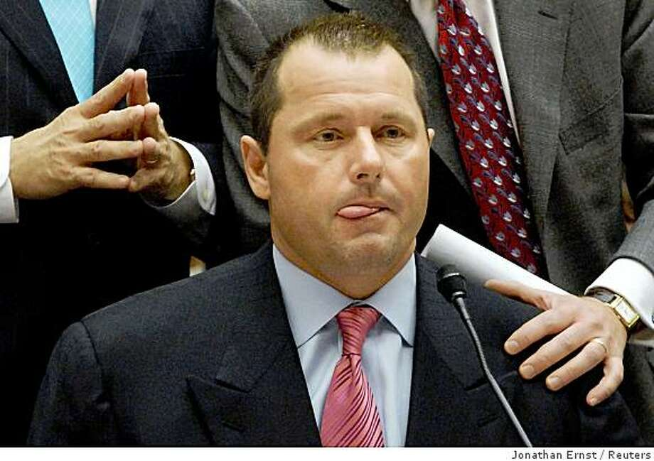 "Former New York Yankee Major League Baseball pitcher Roger Clemens is flanked by his lawyers while testifying before the U.S. House of Representatives Committee on Oversight and Government Reform hearing on ""The Mitchell Report: The Illegal Use of Steroids in Major League Baseball,"" on Capitol Hill in Washington February 13, 2008. Pitching great Clemens and his former trainer Brian McNamee clashed on Capitol Hill on Wednesday over McNamee's claims that he injected Clemens with illegal performance-enhancing drugs.  REUTERS/Jonathan Ernst   (UNITED STATES) Photo: Jonathan Ernst, Reuters"