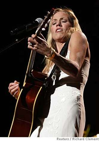 "Sheryl Crow performs on the opening night of her Wildflower Tour in Seattle October 16, 2005. The tour highlights her fifth studio album ""Wildflower."" REUTERS/Richard Clement Ran on: 10-21-2005 Ran on: 10-21-2005 Ran on: 10-03-2006  Sheryl Crow's set made plain who, between her and co-headliner John Mayer, has the better material. 0 Photo: RICHARD CLEMENT"