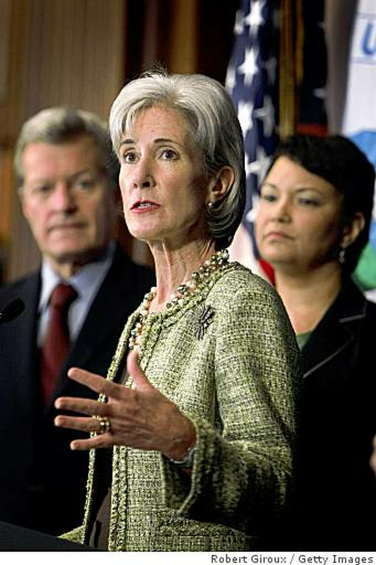 WASHINGTON - JUNE 17: Health and Human Services Secretary Kathleen Sebelius (C) speaks as Senator Max Baucu (D-MT) (L) and EPA Administrator Lisa Jackson listen on June 17, 2009 in Washington, DC. The EPA announced the agency has determined that a public health emergency exists at the Libby asbestos site in northwest Montana. (Photo by Robert Giroux/Getty Images)