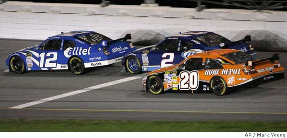 NASCAR driver Ryan Newman (12) passes Tony Stewart (20) on the backstretch as he gets drafting help from Kurt Busch (2) on the final lap of the 50th running of the Daytona 500 auto race at Daytona International Speedway in Daytona Beach, Fla., Sunday, Feb. 17, 2008. Newman won the race. (AP Photo/Mark Young) EFE OUT