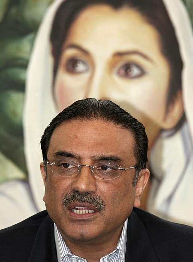 Asif Ali Zardari, husband of Pakistan's slain opposition leader Benazir Bhutto, addresses the media at a news conference in Karachi, Pakistan, Tuesday, Jan. 15, 2008. Zardari told reporters that he had given evidence to British police officers who are assisting Pakistani authorities in the investigation of Bhutto's assassination. (AP Photo/Shakil Adil) Photo: Shakil Adil, Associated Press