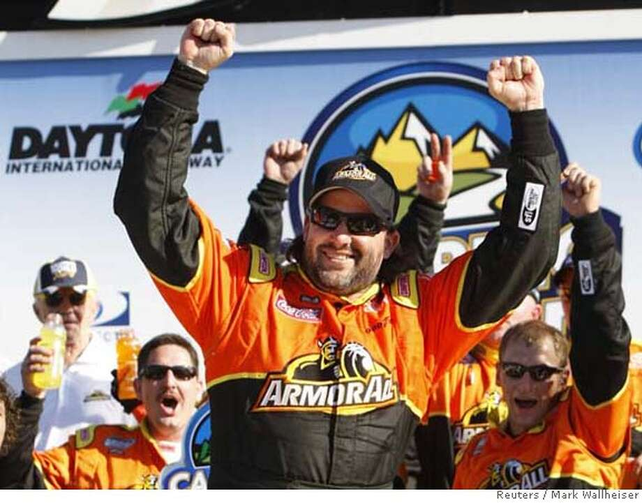 Tony Stewart (C) celebrates his win in the NASCAR Nationwide Series Camping World 300 at the Daytona International Speedway in Daytona Beach, Florida February 16, 2008. The 50th Daytona 500 is scheduled for Sunday. REUTERS/Mark Wallheiser (UNITED STATES) 0 Photo: MARK WALLHEISER