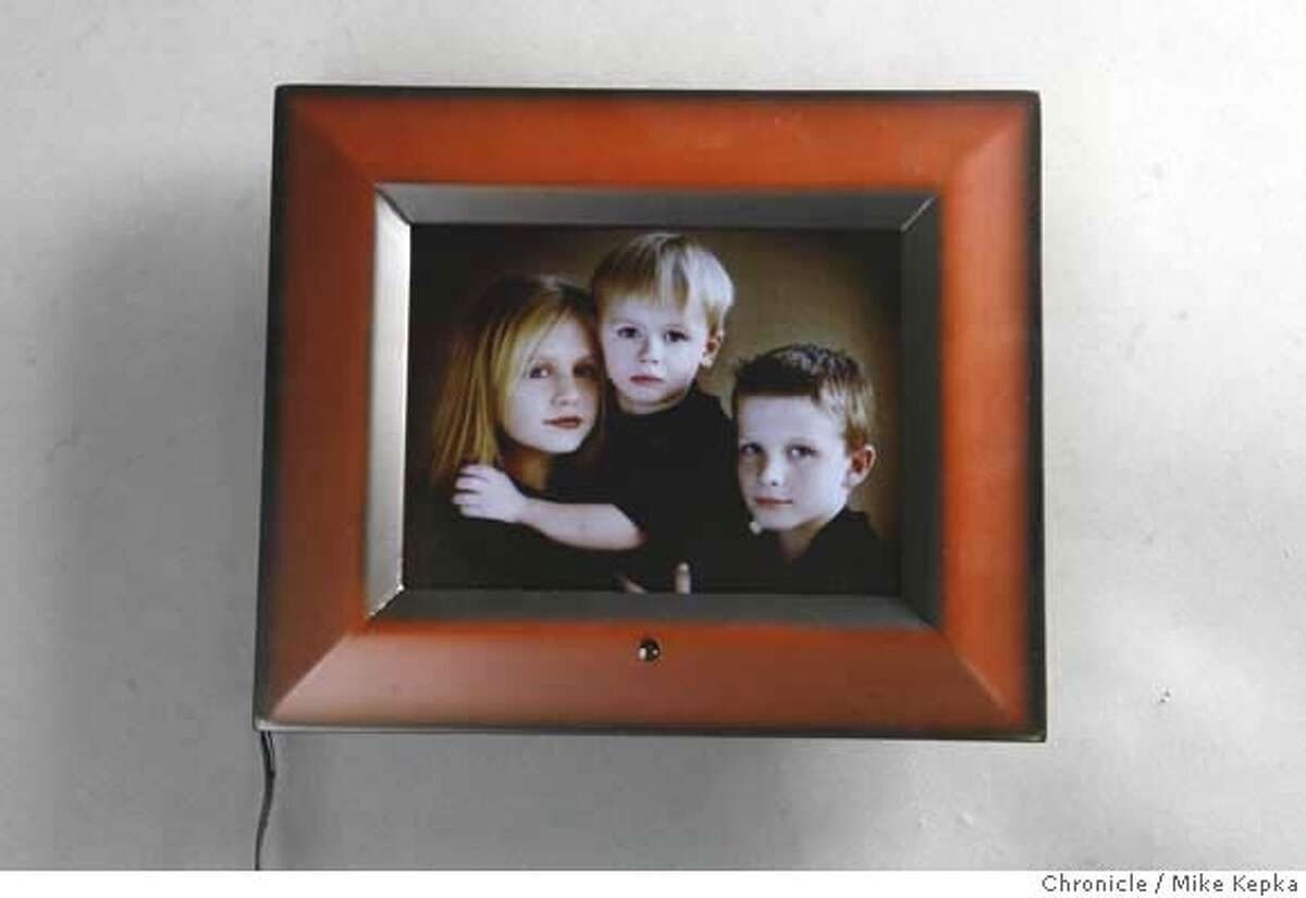 """Sold at Sam's Club, the ADS Digital Photo Frame - 8"""" has reportedly been the vector for cases of malware after a Bethesda research institute specializing in information security reported cases of computers being infected by digital photo frames. Mike Kepka / The Chronicle MANDATORY CREDIT FOR PHOTOG AND SAN FRANCISCO CHRONICLE/NO SALES-MAGS OUT"""