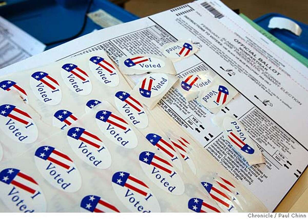Stickers were handed out to voters after casting their ballots at a polling place at fire station No. 4 in Berkeley, Calif. on Tuesday, Feb. 5, 2008.