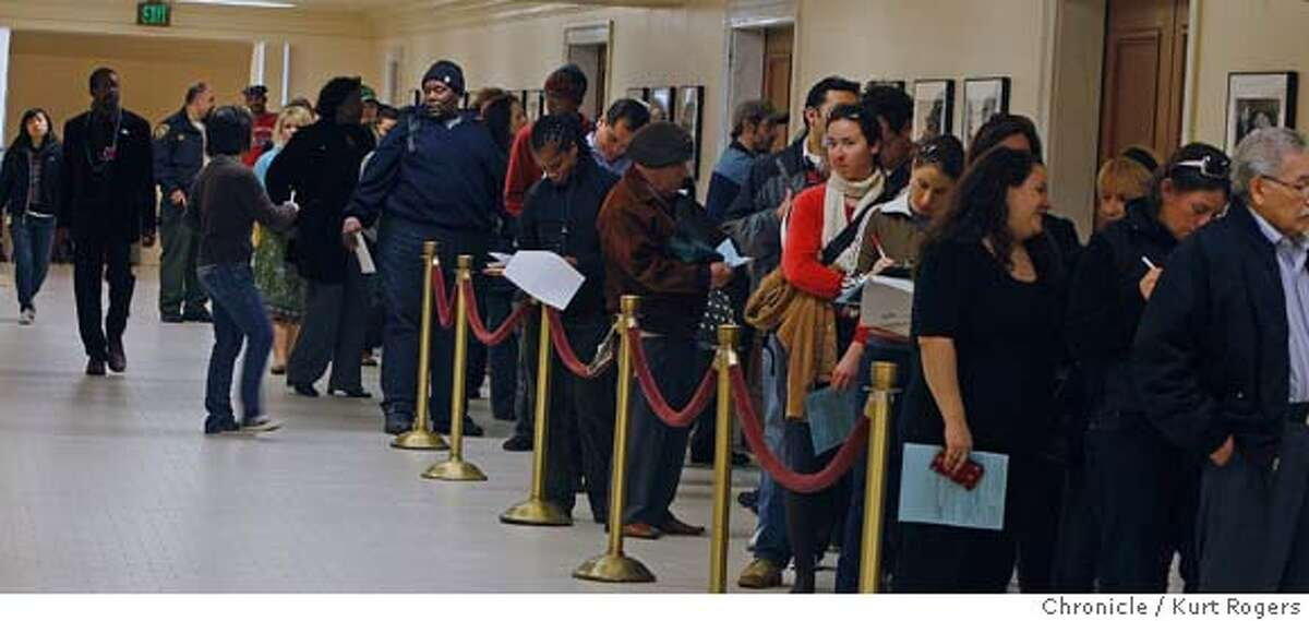 The line of people wanting to vote line the basement of the city hall on their way to the voting booth. Kurt Rogers / The Chronicleg