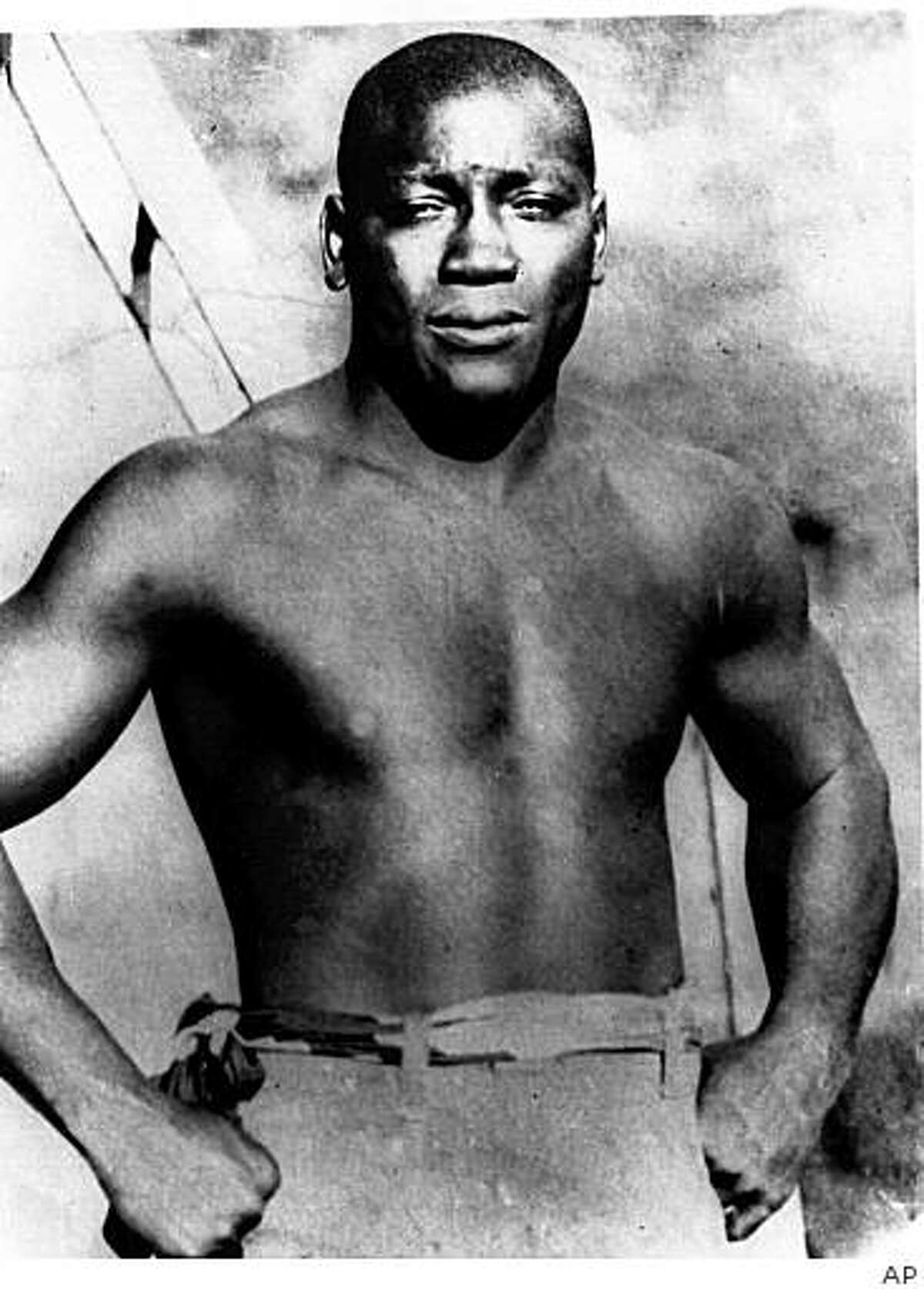 ** FILE ** An undated photo of Jack Johnson, born in Galveston, Texas, who became the first black to win the heavyweight boxing title. He had approximately 113 bouts, losing only six. Johnson was inducted into the Boxing Hall of Fame in 1954. Johnson is the subject of a new documentary by film maker Ken Burns. (AP Photo) timeline_144