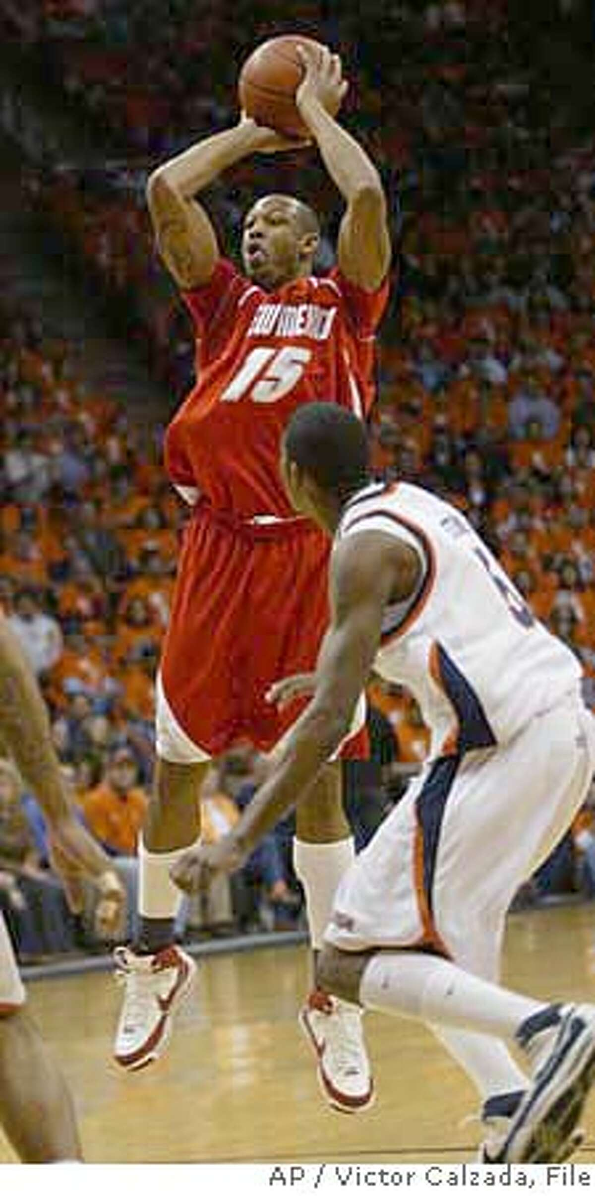 *FILE*New Mexico's J.R. Giddens (15) shoots over UTEP defender Julyan Stone during the first half in this Jan. 2, 2008 file photo, in El Paso, Texas. Giddens is still one of the nation's most capable scoring threats. In many ways, Giddens has been trying to find himself since transferring to New Mexico from Kansas after the 2004-05 season. (AP Photo/El Paso Times, Victor Calzada, File)** EL DIARIO OUT, JUAREZ, MEXICO, OUT ** JAN. 2, 2008 FILE PHOTO EL DIARIO OUT; JUAREZ, MEXICO, OUT; EFE OUT, NO SALES EFE OUT EFE OUT