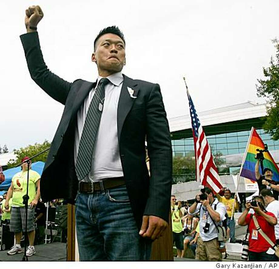 """Lt. Dan Choi, an Iraq combat veteran who was discharged under the U.S. military's """"don't ask, don't tell"""" policy, talks to the audience during a Meet in the Middle 4 Equality rally in Fresno, Calif. on Saturday, May 30, 2009 to protest the California Supreme Court decision to uphold Proposition 8 which bans gay marriage in the state Constitution. (AP Photo/Gary Kazanjian) Photo: Gary Kazanjian, AP"""