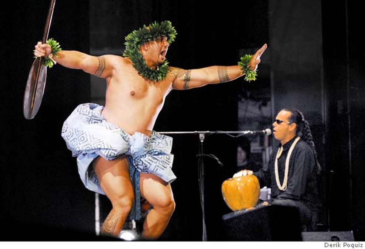 HAWAII CALLS -- Justin Santos of Fremont performs hula accompanied by the chanting and drumming of Mark Keali'i Ho'omalu, the kumu hula (choreographer and director) of the Academy of Hawaiian Arts in Oakland.