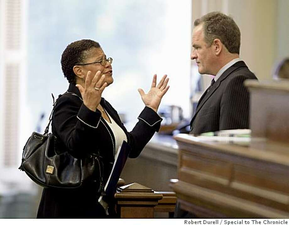 Speaker of the state Assembly Karen Bass (D-Los Angeles), left, speaks with minority leader Sam Blakeslee, right (R-San Luis Obispo) on the floor of the Assembly in Sacramento, California, June 25, 2009. The state legislature is trying to close a $24 billion deficit by July 1, 2009.  With time running out, the state Assembly and state Senate debate are trying to close the deficit. But chances of approval are slim to none with Republicans balking at the Democrats' tax proposals and arguing for deeper cuts. Photo: Robert Durell, Special To The Chronicle
