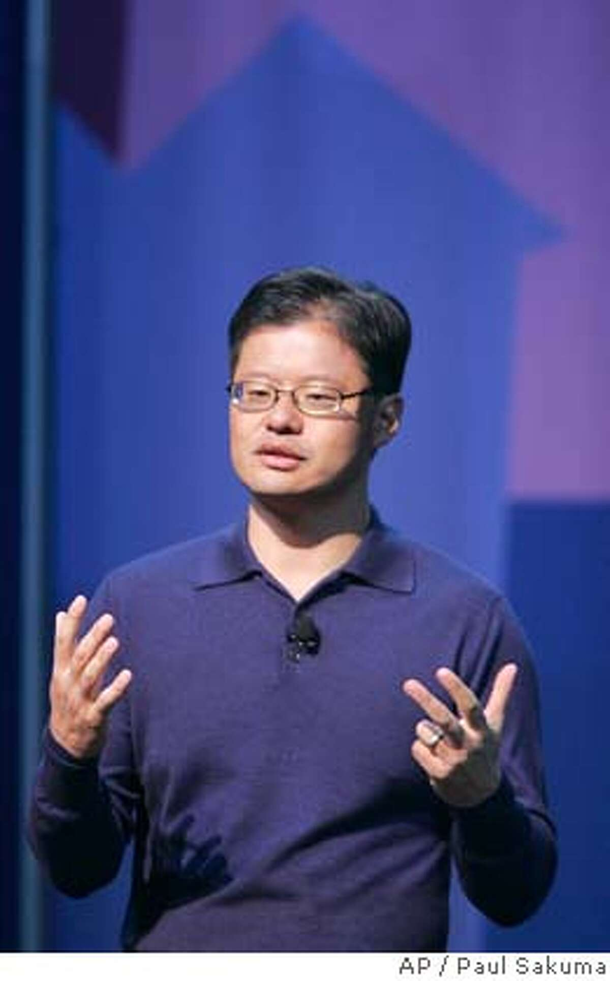 **FILE** Yahoo CEO Jerry Yang gives a keynote address at the Consumer Electronics Show (CES) in Las Vegas, in this Jan. 7, 2008 file photo. Yahoo Inc. Chief Executive Jerry Yang told employees Wednesday Feb. 6, 2008, that the struggling Internet pioneer is still examining ways to avoid a takeover by rival Microsoft Corp. (AP Photo/Paul Sakuma, file)