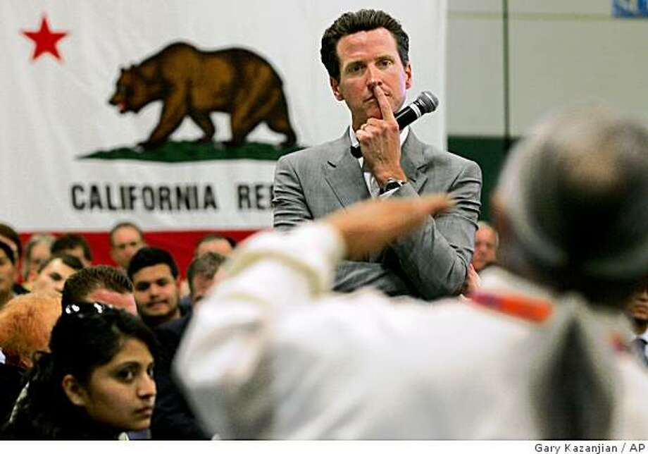 In this photo taken April 29, 2009 Gavin Newsom listens to an audience member's question during an event in Fresno, Calif. San Francisco Mayor Gavin Newsom has been linked to gay marriage ever since he directed city clerks to issue marriage licenses to same-sex couples in 2004.  (AP Photo/Gary Kazanjian) Photo: Gary Kazanjian, AP