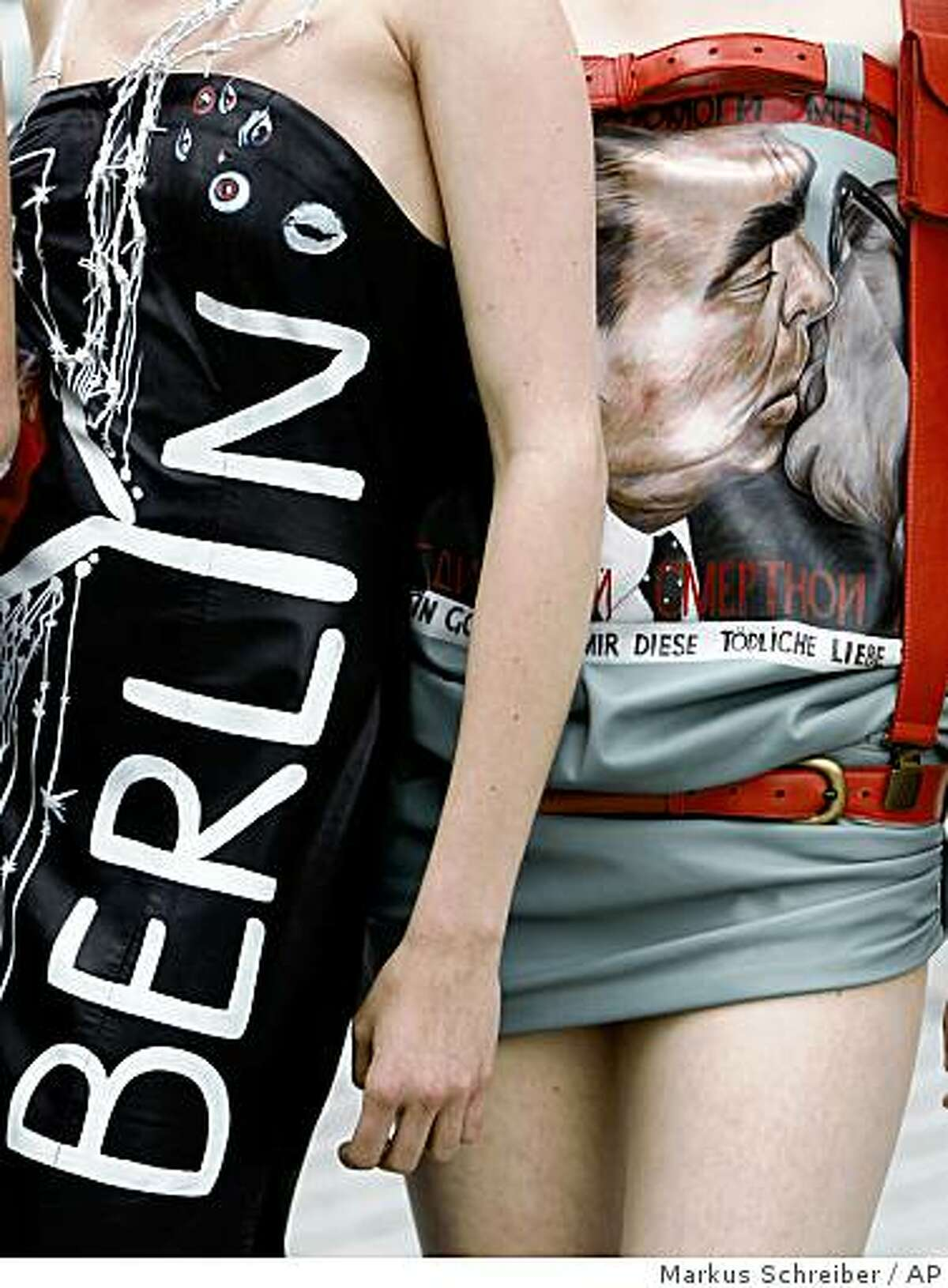 Details of creations by German designer Daniel Rodan with art works from the East Side Gallery in Berlin, including the famous poster of Soviet President Leonid Brezhnev kissing East German Communist leader Erich Hoenecker, as they are presented by model in Berlin, Tuesday, June 9, 2009. A total of 118 artists from 21 countries created the paintings of the so named East Side Gallery, a 1.3 kilometer-long section of the Berlin Wall established in 1990 in the Friedrichshain district of Berlin. (AP Photo/Markus Schreiber)