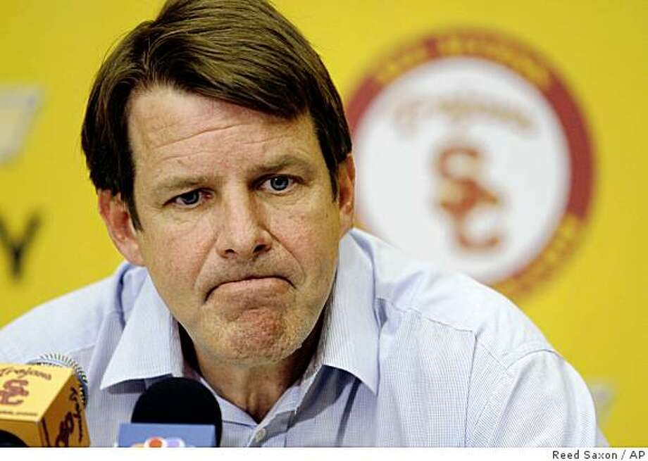 FILE - In this April 2, 2009, file photo, Southern California men's basketball coach Tim Floyd announces he will remain at USC, after considering a position at the University of Arizona, during a news conference in Los Angeles. Floyd reportedly has resigned, one month after being accused of paying someone to help steer former star O.J. Mayo to the school. The Clarion-Ledger of Jackson, Miss., reported Tuesday, June 9, 2009, that Floyd submitted his resignation to athletic director Mike Garrett. (AP Photo/Reed Saxon, File) Photo: Reed Saxon, AP