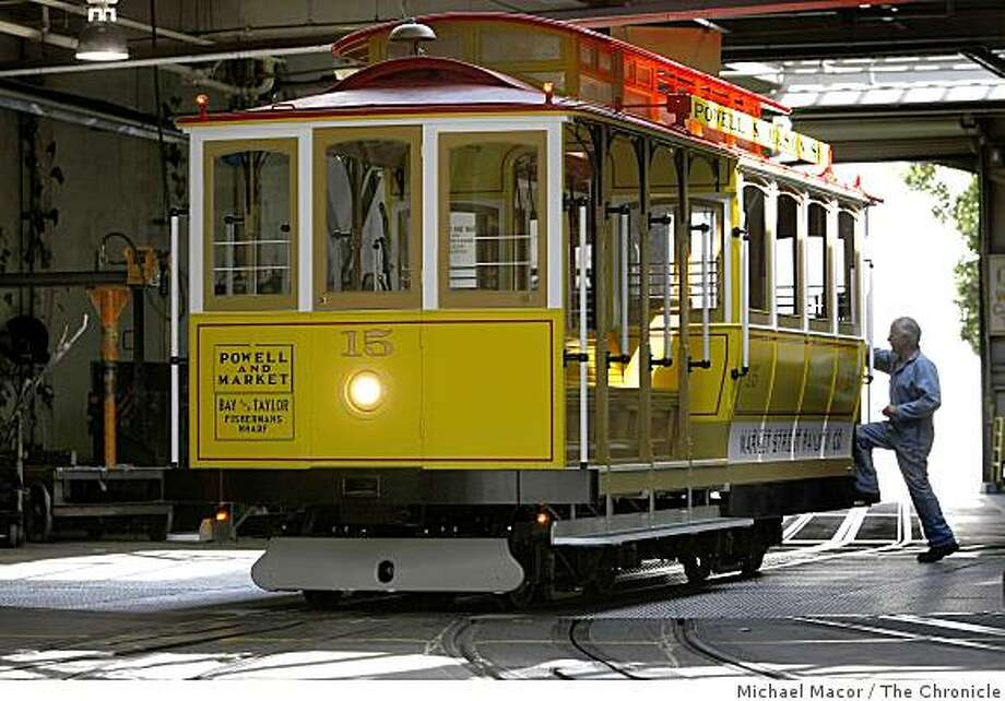 Painter, Larry Harris climbs aboard cable car 15 which makes it's inaugural run on Monday June 22 after  5 years of building the historic vehicle. The car waits at the cable car barn on Thursday June 18, 2009  in San Francisco, Calif. Photo: Michael Macor, The Chronicle