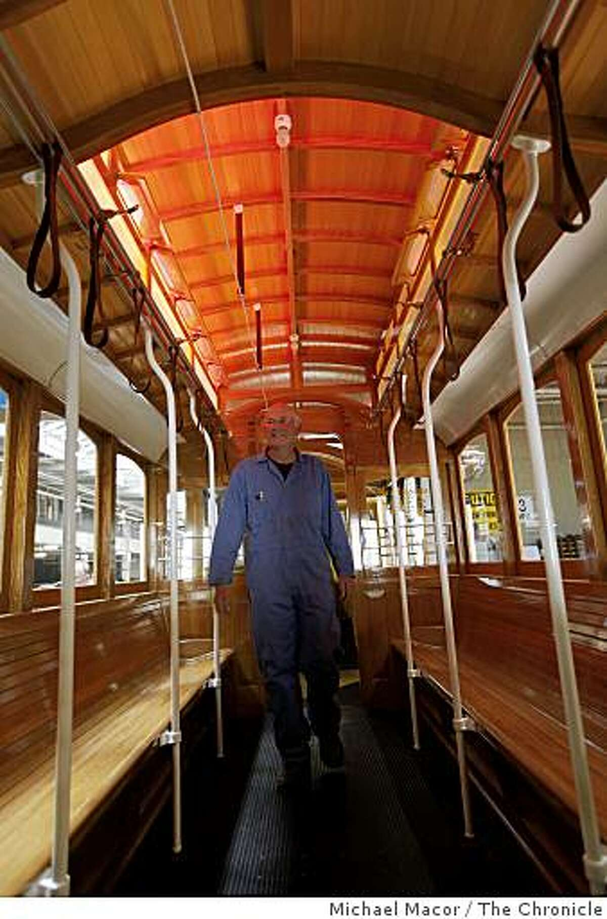 Ken Russi, a painter who worked on the car, walks through cable car 15 makes which makes it's inaugural run on Monday June 22 after 5 years of building the historic vehicle. The car waits at the cable car barn on Thursday June 18, 2009 in San Francisco, Calif.